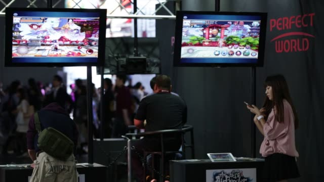 stockvideo's en b-roll-footage met the perfect world co. booth stands at the tokyo game show 2015 at makuhari messe in chiba, japan, on friday, sept. 18, 2015. shots: an attendee,... - television game show