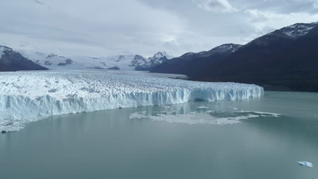 the perito moreno glacier collapsing ice into the lago argentino aerial - parque nacional stock videos & royalty-free footage
