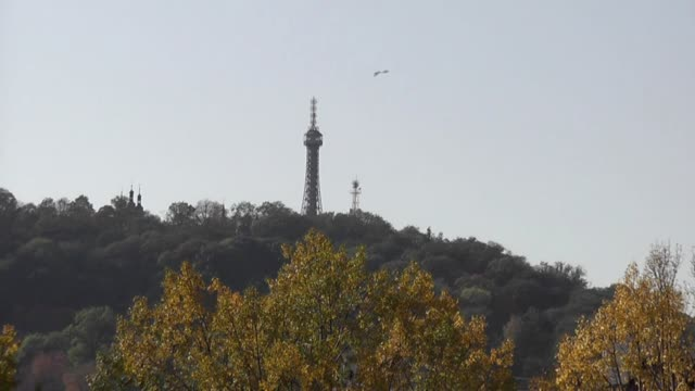 The Petrin lookout tower On hill with autumn trees in foreground