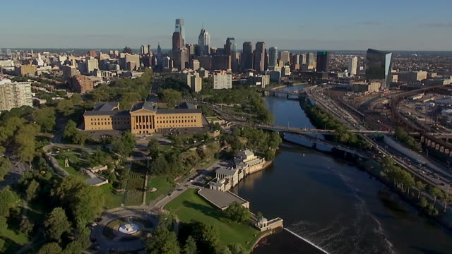 the philadelphia museum of art is in a tree-covered campus near the schuylkill river and benjamin franklin parkway. - center city philadelphia stock videos and b-roll footage