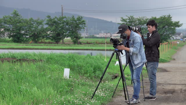 the photographer men filming - documentary film stock videos & royalty-free footage