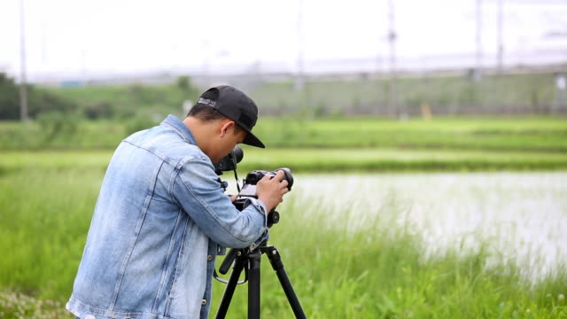 the photographer men filming - documentario video stock e b–roll