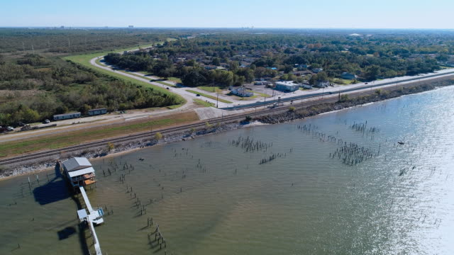The pier and railroad along of the shore of the Lake Pontchartrain, New Orleans, Louisiana, USA. Aerial drone video with the static camera.