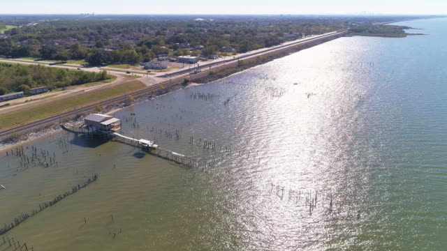 The pier on the Lake Pontchartrain, New Orleans, Louisiana, USA. Aerial drone video with the panoramic and wide-orbit camera motion.