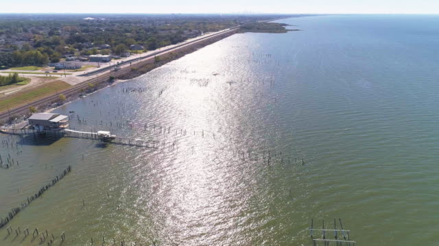 The pier on the Lake Pontchartrain, New Orleans, Louisiana, USA. Aerial drone video with the panoramic rotating-around camera motion.