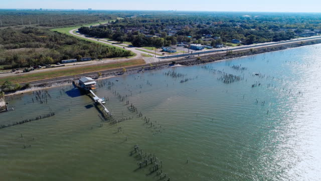 The pier on the Lake Pontchartrain, New Orleans, Louisiana, USA. Aerial drone video with the backward  camera motion.