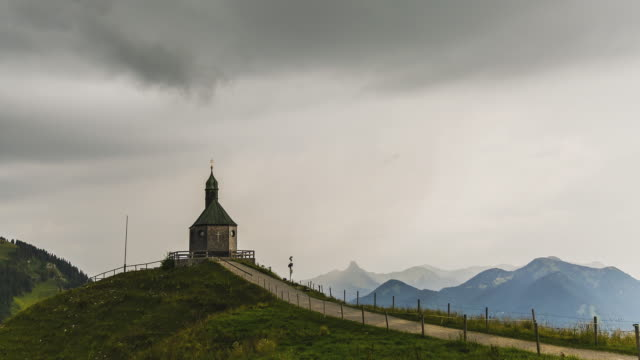 vídeos y material grabado en eventos de stock de t/l of the pilgrimage church at the summit of mount wallberg on a stormy day - gris