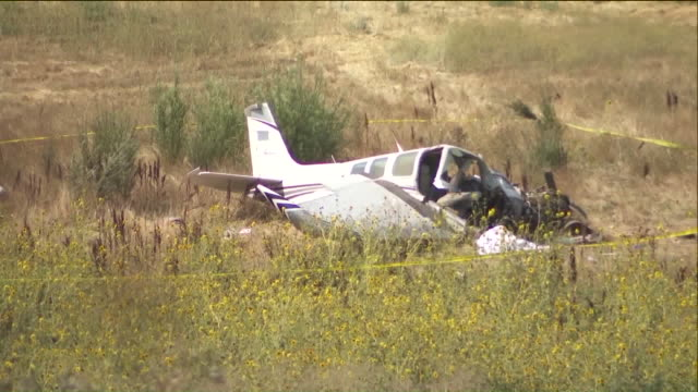the pilot of a small plane who died after the aircraft crashed in the sylmar area on sunday afternoon has been identified by the l.a. county coroner... - 検死官点の映像素材/bロール
