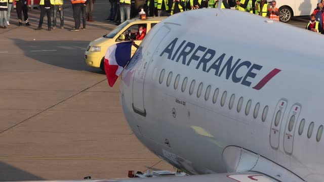the pilot of an air france passenger plane holds the french flag out of the window of the moving aircraft towards the runway for departure as the... - french flag stock videos & royalty-free footage