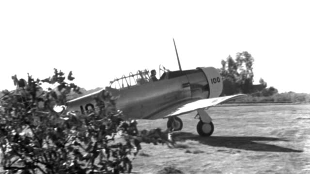 the pilot quickly climbs out of a wwii trainer aircraft after it comes to a spinning stop. - propeller stock videos & royalty-free footage