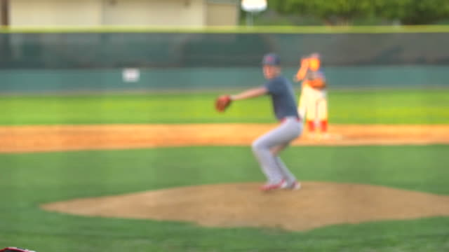 the pitcher at a baseball game throws the ball to the batter. - slow motion - baseball pitcher stock videos & royalty-free footage