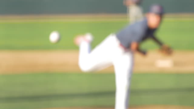 stockvideo's en b-roll-footage met the pitcher at a baseball game throws the ball to the batter. - slow motion - baseball uniform