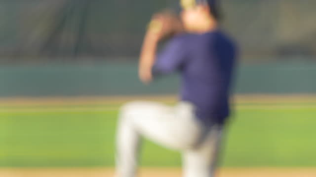 vídeos y material grabado en eventos de stock de the pitcher at a baseball game throws the ball to the batter. - guante de béisbol