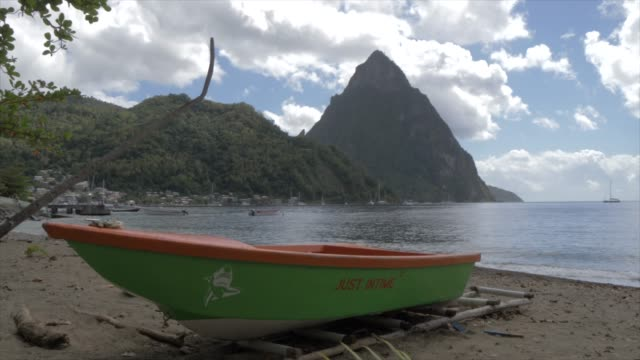 the pitons from soufriere beach, unesco world heritage site, st. lucia, windward islands, west indies caribbean, central america - st lucia stock videos & royalty-free footage