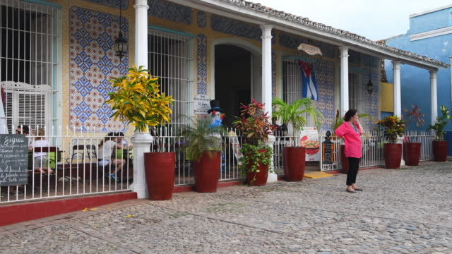 The place is popular with visitors Notice the colorful pattern in the front wall and also the cobblestone street Trinidad village is a Unesco World...