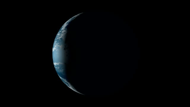 the planet earth slowly rotating, mostly in shadow with a crescent of light on it's side. - 1 minute or greater stock videos & royalty-free footage