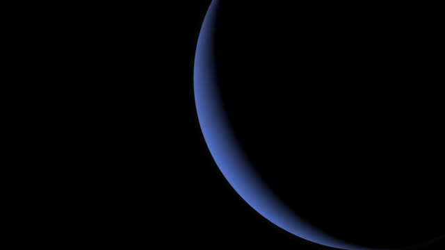 The planet Neptune rotates in black space.