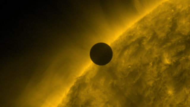 the planet venus appears as a small dark spot passing across the face of the sun the transit of venus is one of the rarest predictable celestial... - weltraum und astronomie stock-videos und b-roll-filmmaterial