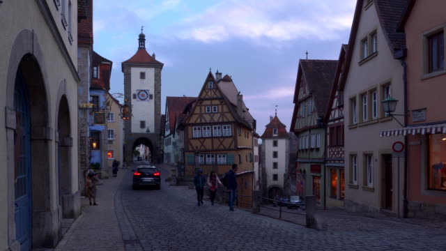 the ploenlein with sieber tower and kobolzeller tower at dusk twilight. - romantic road germany stock videos and b-roll footage