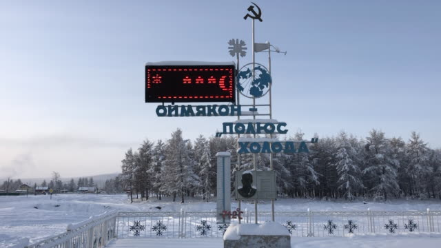the pole of cold monument in the centre of oymyakon, the coldest permanently inhabited place on earth - russia stock-videos und b-roll-filmmaterial