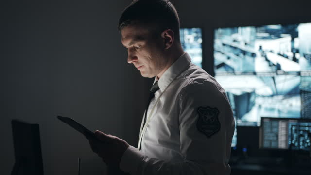the police officer uses high technology and a tablet to view important information that he can receive in real time, which allows him to react quickly to offenses. - 4k resolution stock videos & royalty-free footage