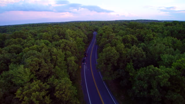 the police stopped the violator on the long pond road, pennsylvania, poconos, usa. aerial drone video. - country road stock videos & royalty-free footage