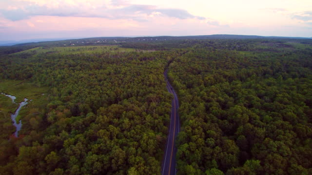 the police stopped the violator on the long pond road, pennsylvania, poconos, usa. aerial drone video. - two lane highway stock videos & royalty-free footage