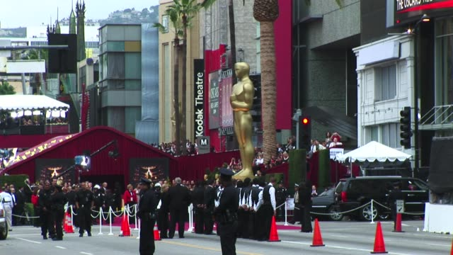 The police valets and the giant Golden Oscar statue awaits the chosen quests and limos at the Hollywood Boulevard entrance to the Oscars Academy...