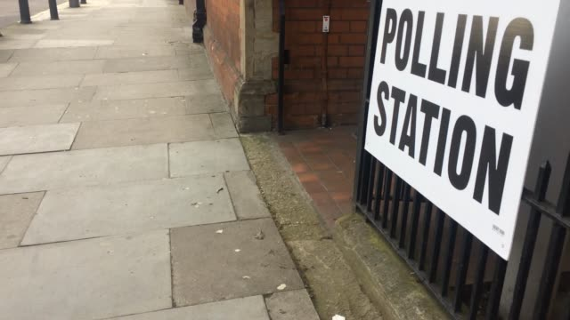 the polling station sign outside lea bridge road library as people go to the polls in the english local council elections on may 3 2018 in london... - välja bildbanksvideor och videomaterial från bakom kulisserna
