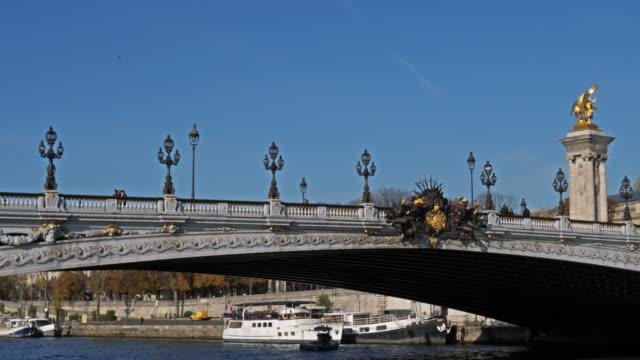 the pont alexandre iii overcrossing the river seine. paris, france - アレクサンドル3世橋点の映像素材/bロール
