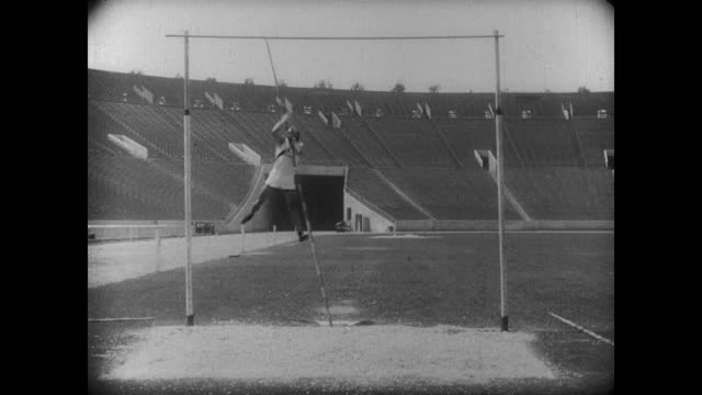 1927 The popular girl watches athlete (Buster Keaton) attempt to perform the pole vault