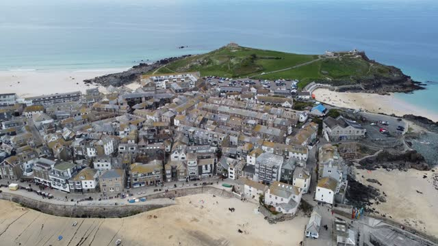 the popular tourist seaside town of st ives, close to the carbis bay estate hotel and beach, which is set to be the main venue for the upcoming g7... - イングランド コーンウォール点の映像素材/bロール