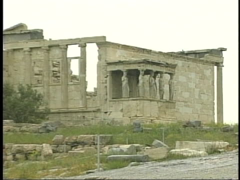 the porch of maidens adorns one section of the erechtheum on the acropolis in athens - ペディメント点の映像素材/bロール
