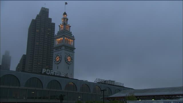 stockvideo's en b-roll-footage met the port of san francisco clock tower is seen - veerbootgebouw