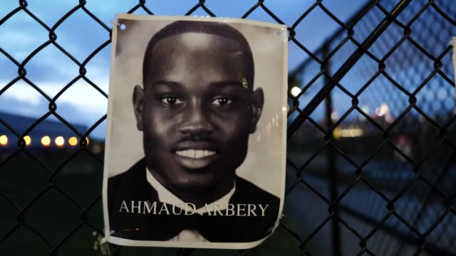 the portrait of the late ahmaud arbery hangs on a waterfront fence on september 13, 2020 in williamsburg, brooklyn, new york city. the new memorial... - memorial点の映像素材/bロール