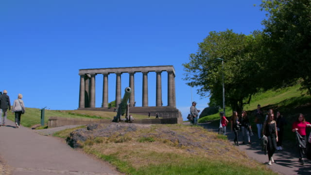 the portugese cannon & national monument of scotland, calton hill, edinburgh, scotland - calton hill national monument stock videos and b-roll footage