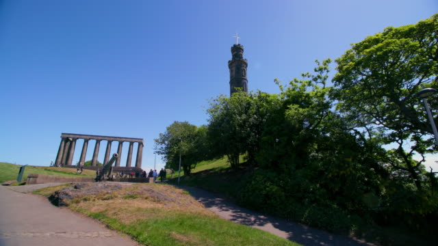 the portugese cannon, national monument of scotland & the nelson monument, calton hill, edinburgh, scotland - calton hill national monument stock videos and b-roll footage