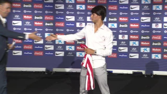 The Portuguese Joao Félix from Benfica FC is presented as a new Atlético de Madrid's football player by the president of the club Enrique Cerezo at...
