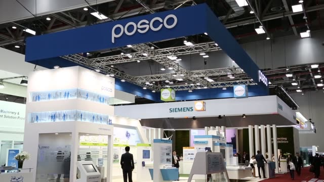 the posco logo is displayed at the company's booth at the the 22nd world energy congress in daegu south korea on wednesday oct 16 attendees visit the... - daegu stock videos and b-roll footage