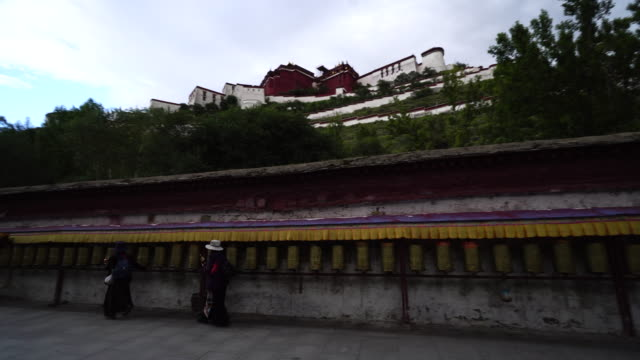 the potala palace in lhasa, the largest and most complete ancient palace complex in tibet, is now a museum and listed on unesco world heritage site. - pilgrim stock videos & royalty-free footage