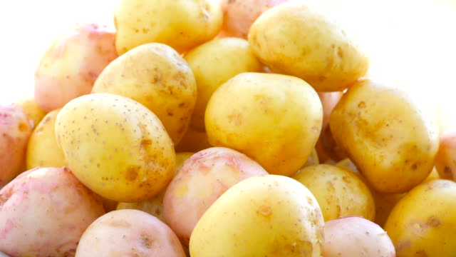 the potatoes in a colander after washing