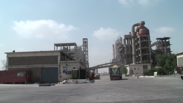 the power cement ltd plant operated by arif habib group stands in nooriabad sindh pakistan on monday may 22 employees walk through the power cement... - sindh pakistan stock videos and b-roll footage
