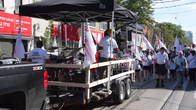 the power workers union truck with caribbean music the toronto labor day parade is a traditional annual event in the canadian city capital of the... - trade union stock videos & royalty-free footage