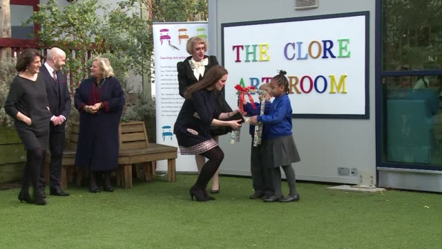 the pregnant duchess of cambridge kate middleton met cross dressing artist grayson perry and a throng of cheering schoolchildren thursday as she... - duchess of cambridge stock videos and b-roll footage