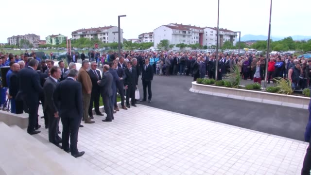 vídeos de stock, filmes e b-roll de the president of montenegro's football association dejan savicevic and fifa president gianni infantino attend the inauguration ceremony of the house... - gianni infantino