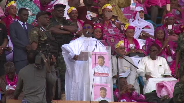 the president of niger mahamadou issoufou holds a rally at a packed stadium in niamey ahead of sundays presidential election - mahamadou issoufou stock videos and b-roll footage