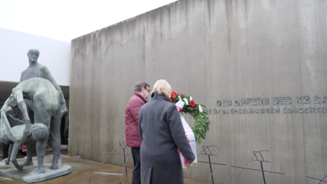 the president of the state parliament of brandenburg ulrike liedtke lays a wreath to commemorate the victims at the sachsenhausen concentration camp... - prison camp stock videos & royalty-free footage