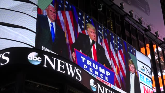 stockvideo's en b-roll-footage met the presidential general election results between donald trump and hillary clinton was televised via giant electronic billboard screens in times... - presidentsverkiezing