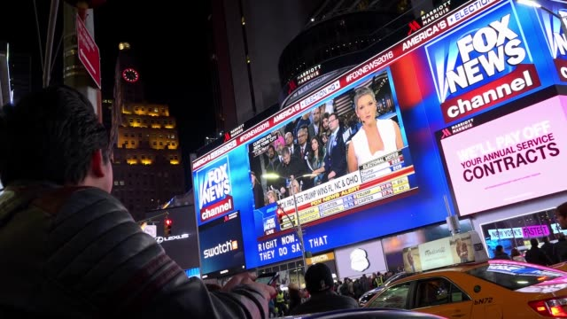 the presidential general election results between donald trump and hillary clinton were televised by fox news and abc news via giant electronic... - electronic billboard stock videos and b-roll footage
