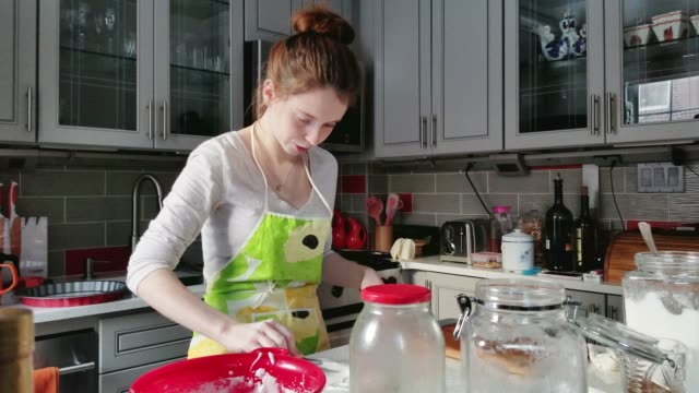 the pretty teenager girl cooking - making sweet pastries in the kitchen - food state stock videos & royalty-free footage